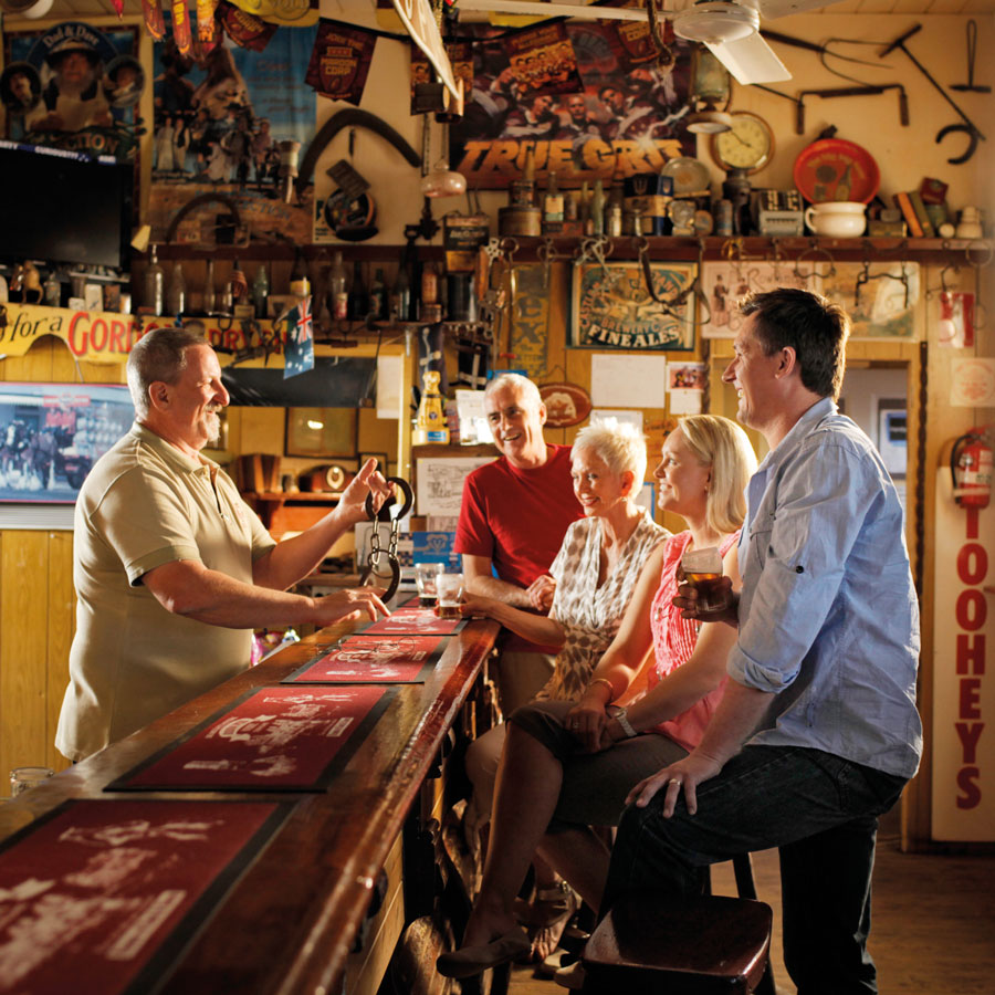 Guests talking to the staff over pub counter