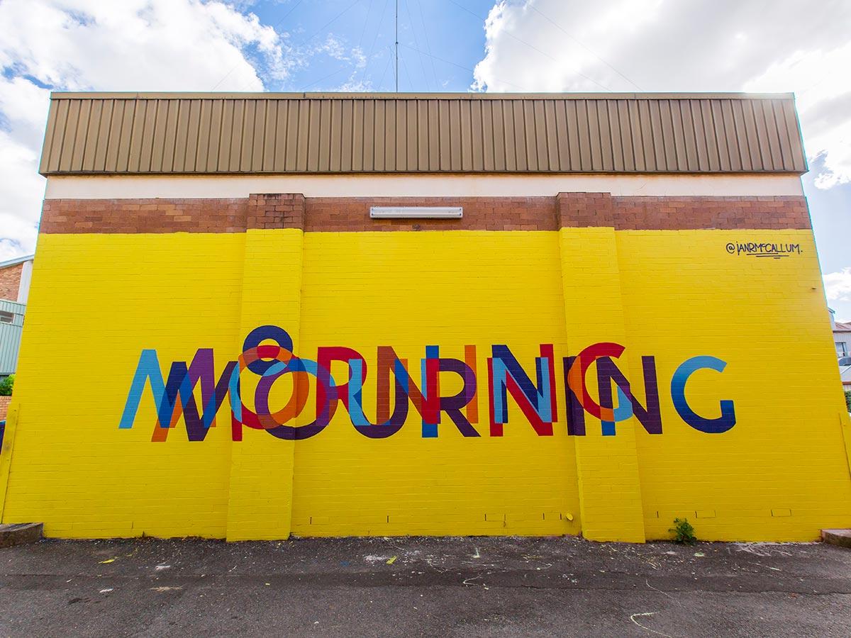 Bright yellow street art in Toowoomba laneway