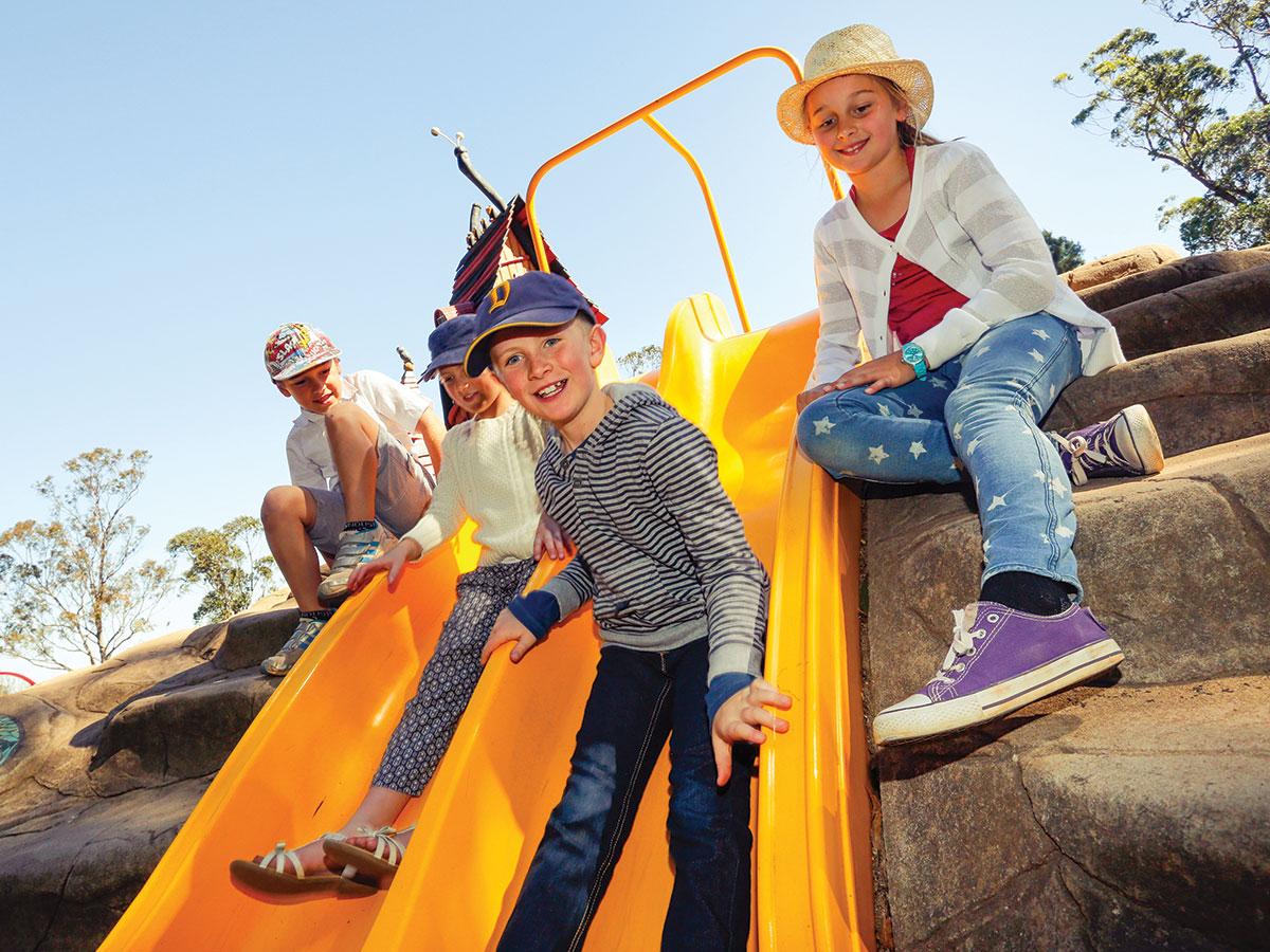 Kids on yellow slide at playground in Toowoomba