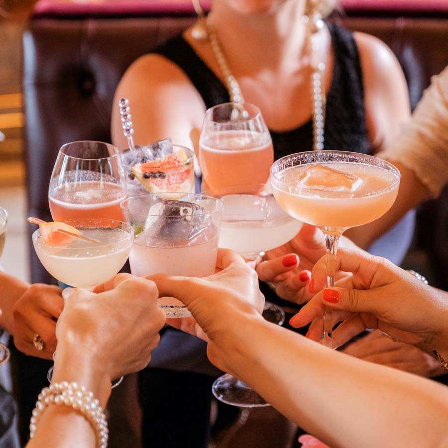 Women cheers their cocktail glasses