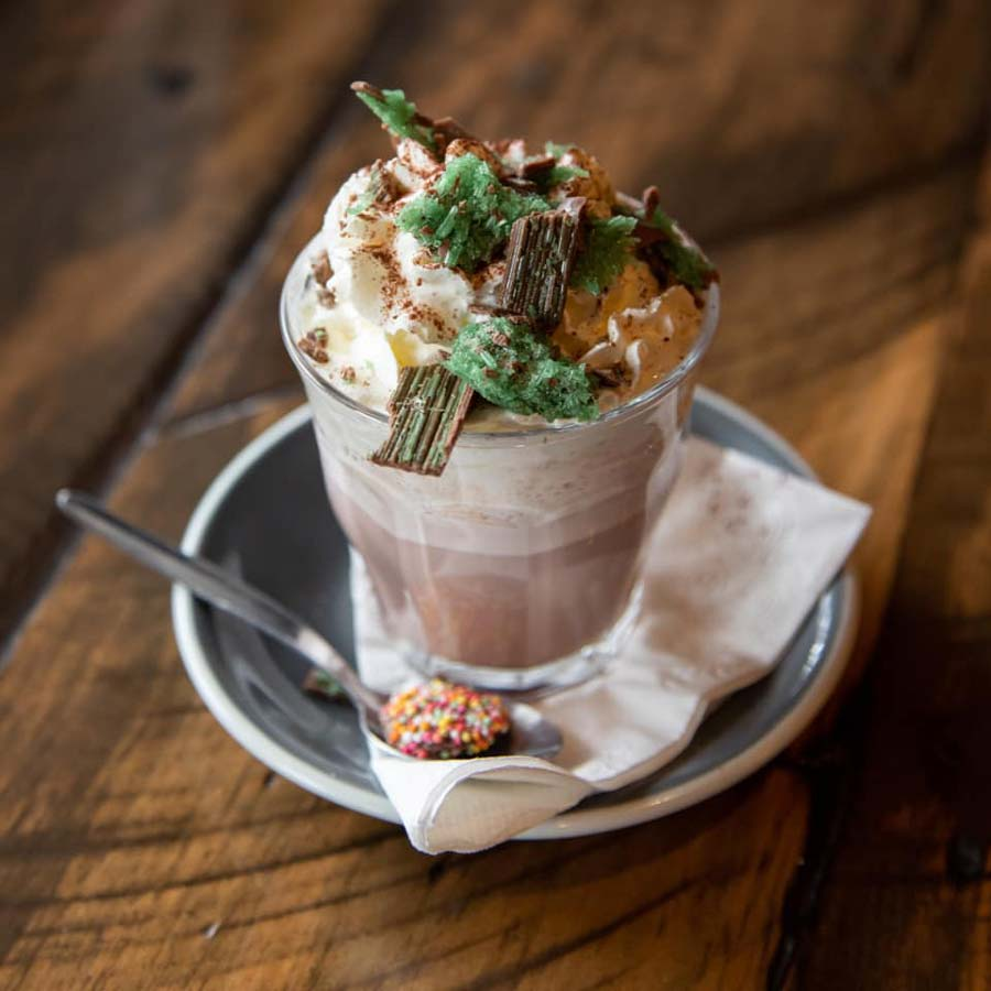 Hot chocolate with cream and mint lolly on top