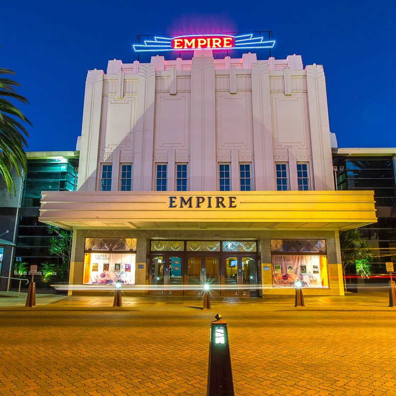Empire Theatre at night with lights on