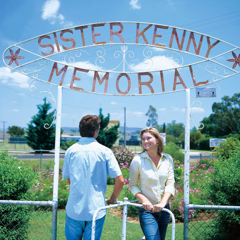 Man and Woman standing under entry sign for Sister Kenny Memorial