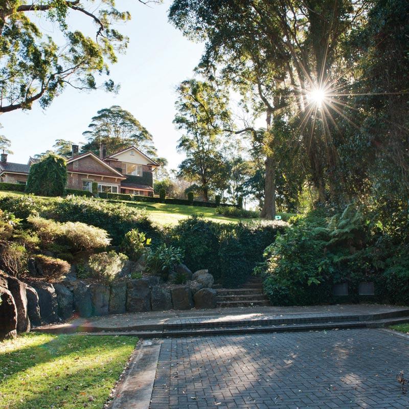 Boyce Estate on top of green grassy hill