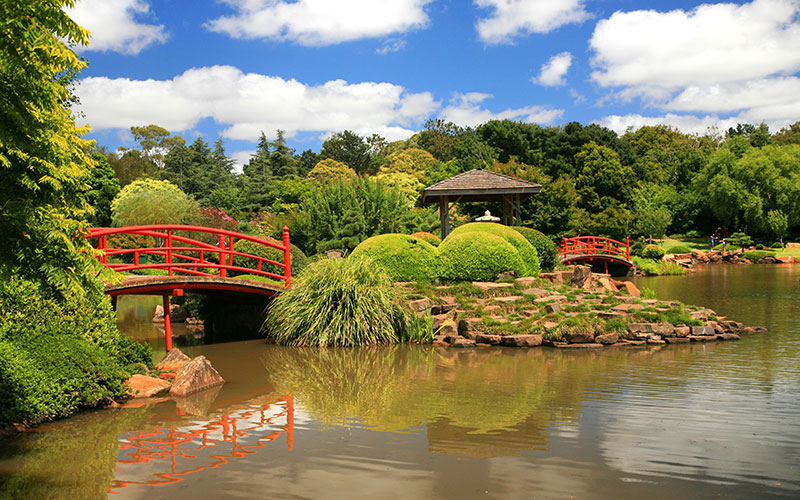 Japanese Gardens with lake and red bridge