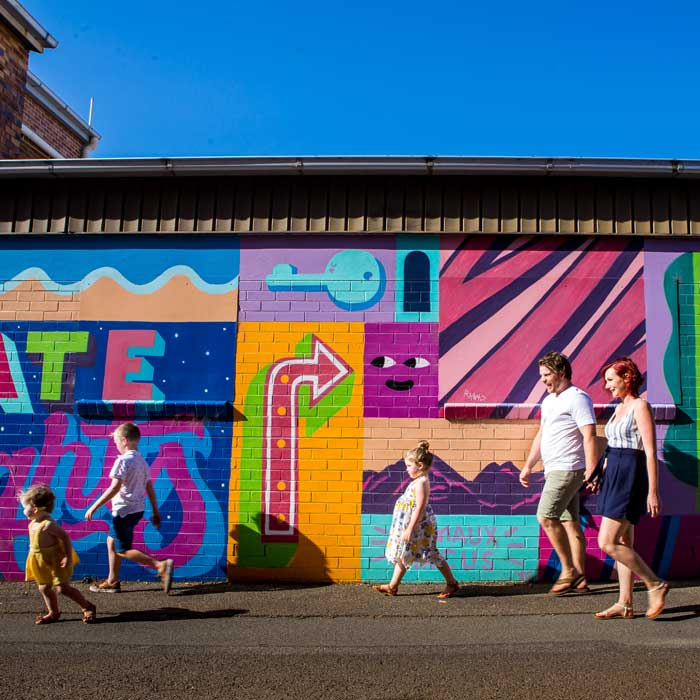 family walking through street art in Toowoomba